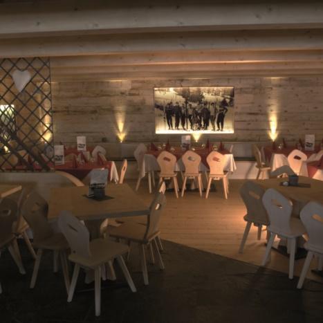 Sala pranzo con rivestimento in Legno Vecchio e parti in ferro. Pavimento in pietra.